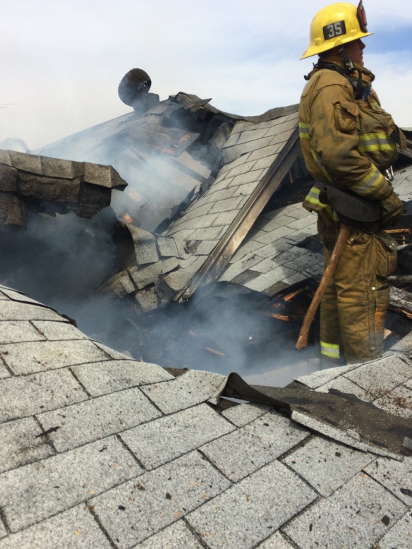 Firefighter on roof by LAFD-CC