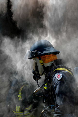 Firefighters In Smoke by Ross Beckley - CC