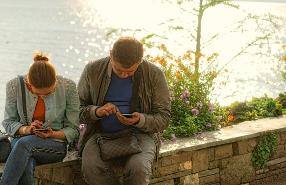 couple-reading-their-phones.jpg