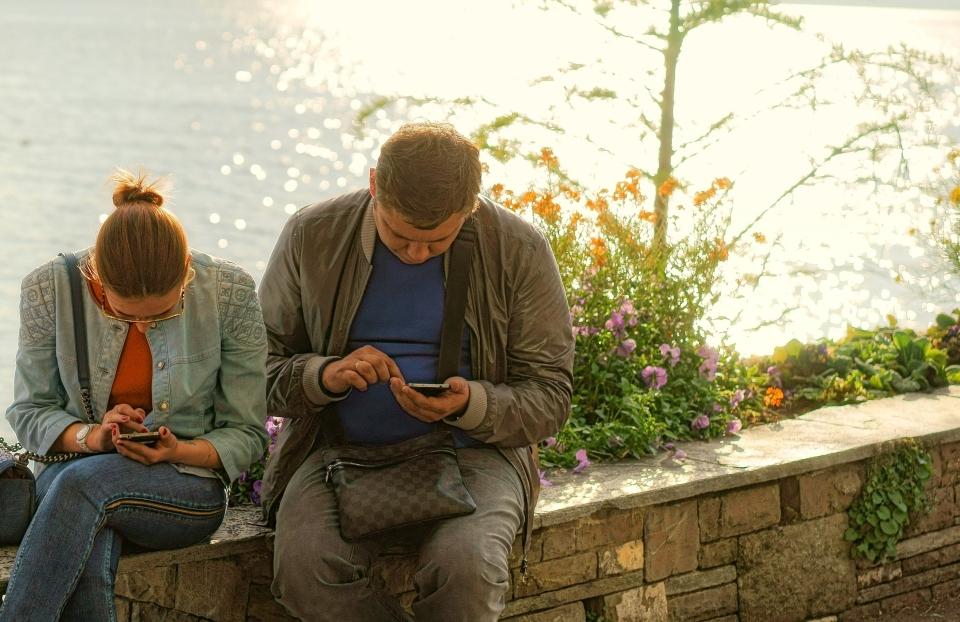 couple-reading-their-phones.jpg