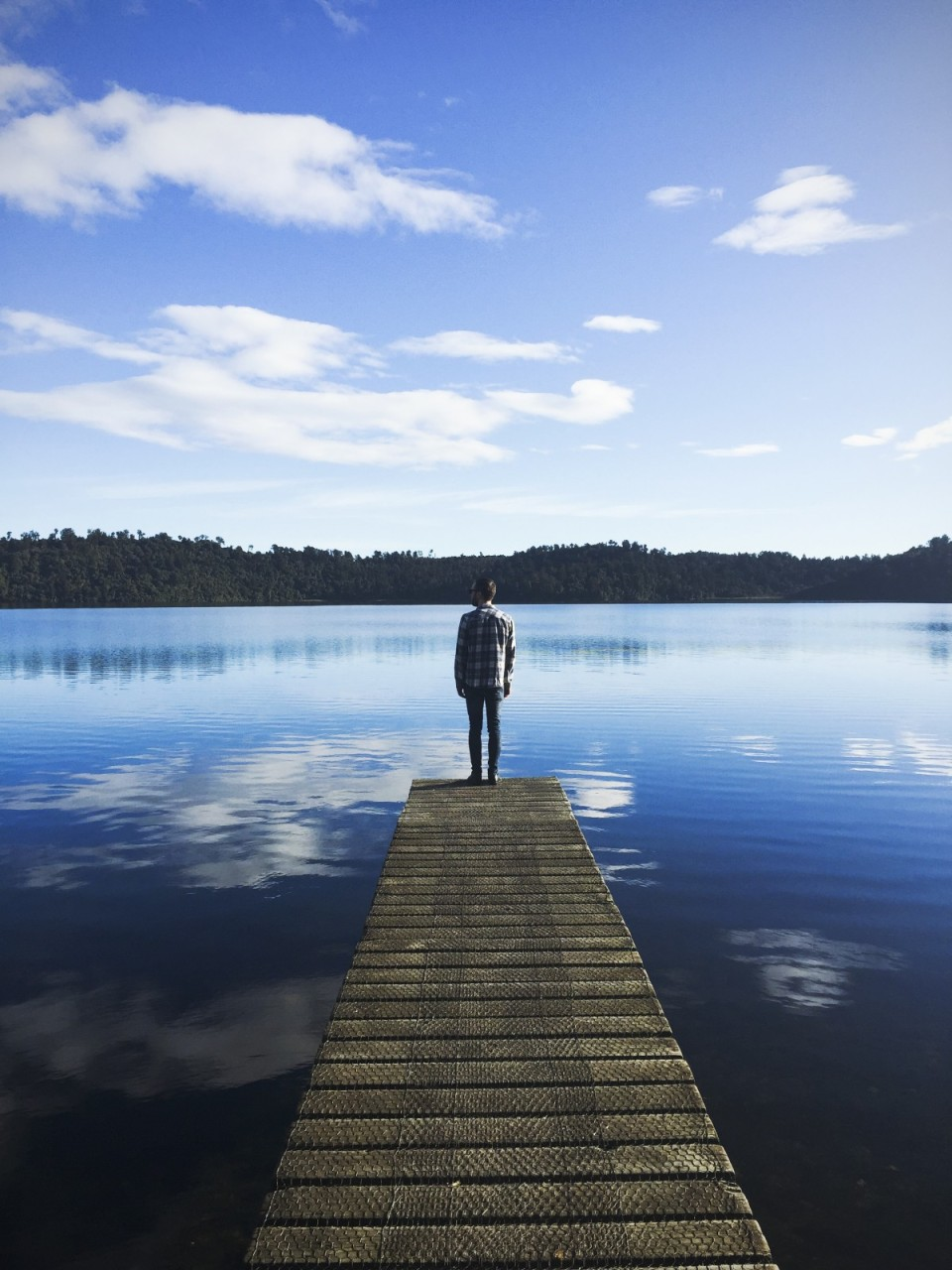 peaceful man at end of pier via pxhere - public domain